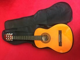 Stagg C510 1/2 Size Classical Guitar - Natural. Good condition with strapped case.