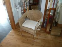 Wicker/rattan bedroom/conservatory chair. Nice and tidy with cushion.
