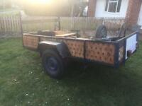 8x5 trailer fully brakes drop down back. Light board offers