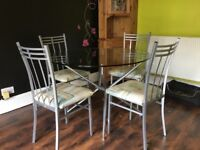 Glass Kitchen/dining table and 4 chairs