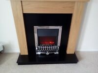 Solid oak fire surround with electric fan assisted fire
