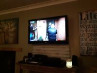 "42"" LG PLASMA TV WITH LG THEATRE SYSTEM INC DVD PLAYER AND SURROUND SOUND SPEAKERS"