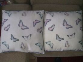 2 butterfly cushions