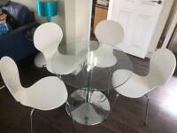 Circular glass-top table with 4 Chairs