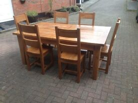 Solid oak dinning table with 8 chairs