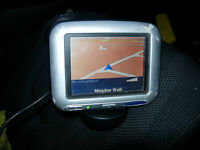 TOM-TOM sat nav with windscreen fitting.