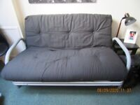 USED 1 WEEK MEXICO 2 SEATER FUTON SOFA BED BLACK £ 99 ONLY FOR QUICK SALE !!!!