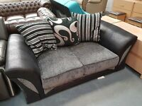 Brand New Black And Grey 2 x 2 Seater Sofas. Ready For Pick Up Or Delivery. RRP 649.