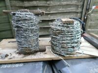 TWO REELS OF BARBED WIRE