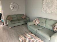 2 x DFS 3 seater sofas plus footstool