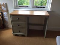 Attractive wooden and Farrow and Ball painted desk in good condition with beautiful drawer knobs,