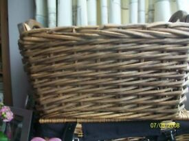 Large wicker hand crafted storage basket with handles .
