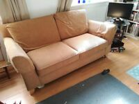 Sand coloured sofa. Large 2 seater could fit 3 at a squeeze. Corduroy texture.