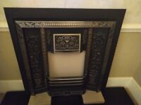 Cast iron fire insert and marble hearth.
