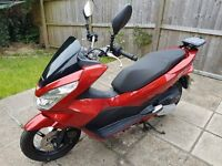 Honda PCX125 in red. Only 1020 miles from new. Some minor damage to front panels.
