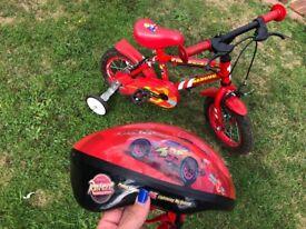 Child's 12 inch wheels fire rescue bike and Disney cars helmet