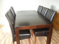 Dark wood table and 6 brown leather chairs