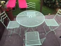 Lovely Metal table and chair garden set
