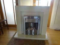 Electric fire and surround cream