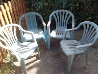 4 GREEN PLASTIC RESIN GARDEN CHAIRS AND SMALL BISTRO TABLE