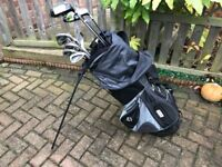 "Oversize Wilson golf clubs, Ping putter, ""woods"" and TaylorMade bag, stand & Cover"