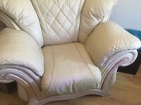 2 cream leather chairs