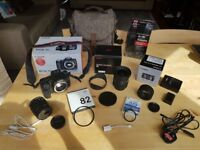 Canon 70D DSLR camera with various lenses and Harris Tweed camera bag