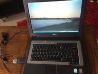Dell Inspiron 1300 laptop (second-hand), Microsoft Windows XP + Digitech mouse + Hi Point webcam