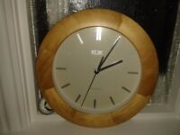 Radio controlled wood surround clock approx 10 inches in diameter