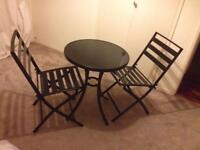 Small black glass round table and 2 chairs