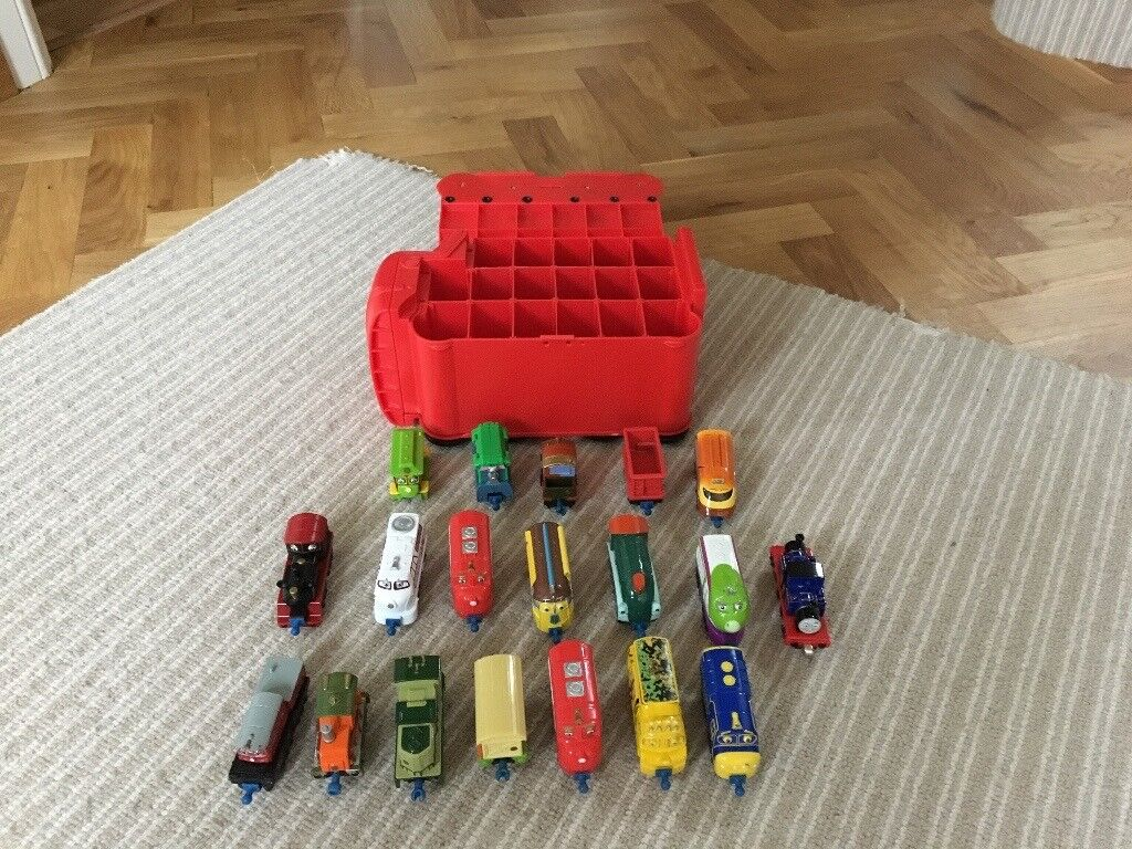 Chuggington trains 18 with carry case and one Thomas train