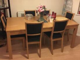Extendable dining table and set of 6 chairs