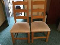Two Solid Oak Kitchen Chairs. Willing to sell seperately. £25 each