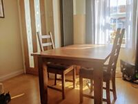 sturdy extendable dining table + 4 chairs + 4 seat cushions