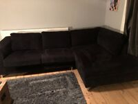 Sofology black 4 seater corner sofa with matching chair and storage foot stool