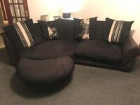 Black sofa with cuddle chair