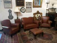 Classic vintage style leather sofa and chairs.