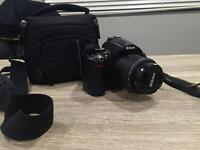 Selling Nikon D5000 SLR camera- great condition, brand new lens