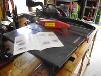 Brand new 800w Power table saw and table extension.
