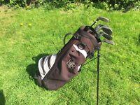 Black golf bag with golf clubs