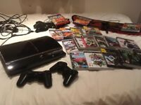 PS3 with 2 controllers , variety of games and accessories