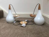 2 white pendant lights