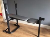 York Fitness weights bench with barbell.
