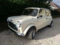 Meet Kenny, lovingly restored prize winning Classic Mini. Beautiful bodywork. Recon engine purrs.