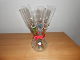 SIX CHAMPAGNE GLASSES IN A VASE