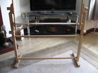 tapestry/cross stitch stand. It will take a large cross stitch so your hands are free to sew