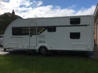 Swift Exclusive 6 berth Caravan, bunk beds and Rally Air 390 Awning