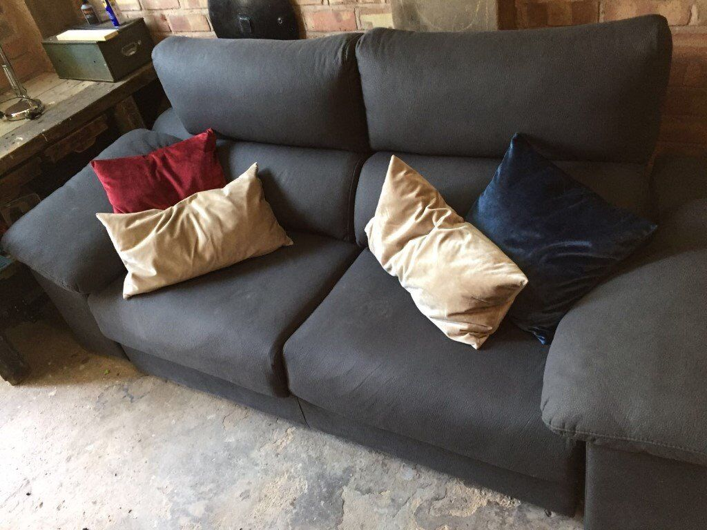Two-seat grey sofa plus footstool and cushions !!