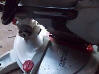 Compound mitre saw with broken guide does have a dewalt blade fitted