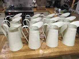 12 cream tin jugs perfect for weddings